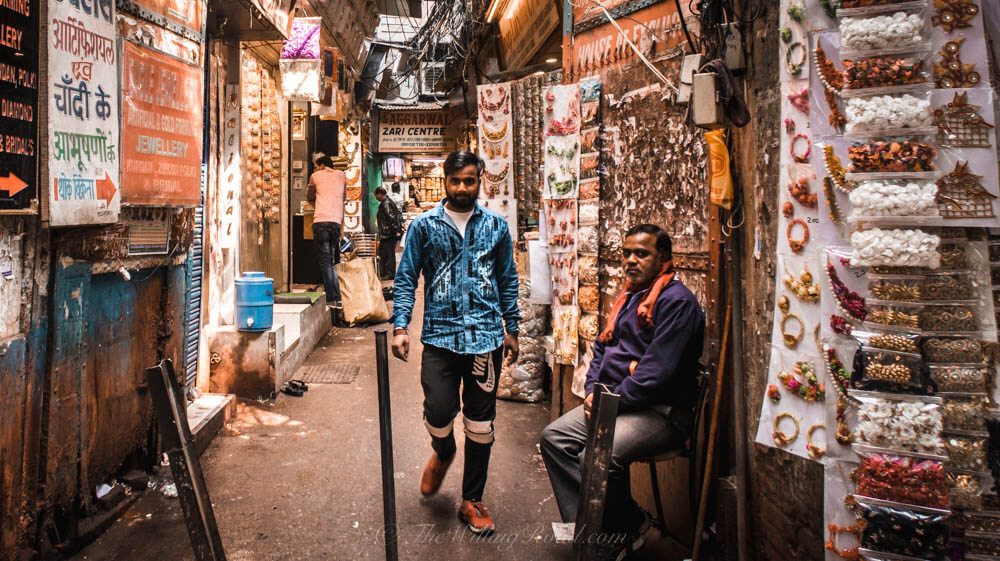 Chadni Chowk: Men in an alleyway of shops
