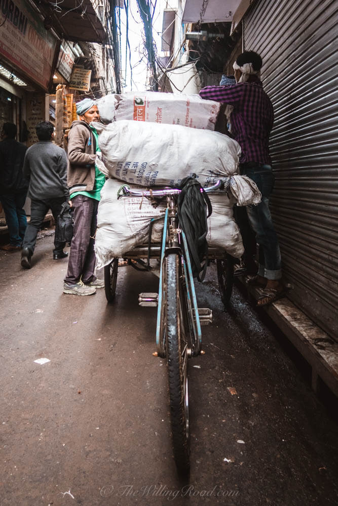 Chadni Chowk: Men load a bike with cargo